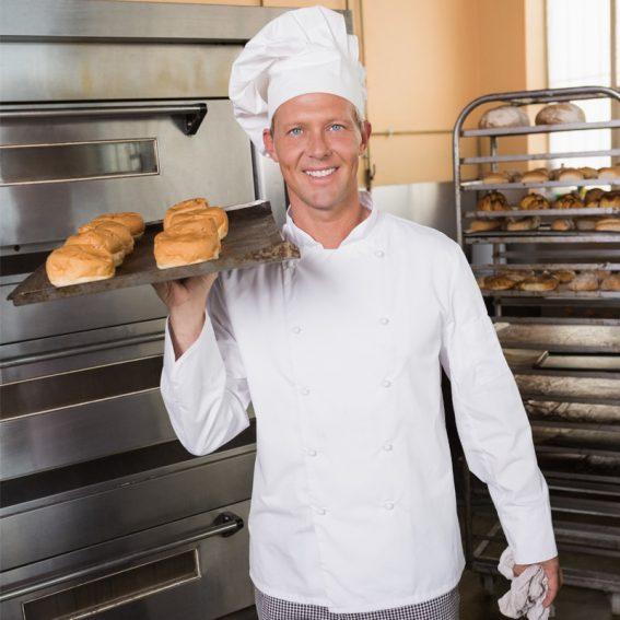 baker-holding-tray-of-fresh-bread